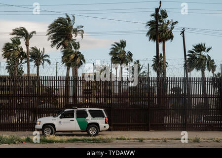 A border patrol vehicle sits in front of the border fence in Calexico, California on April 4, 2019. President Trump is scheduled to make a trip to Calexico on Friday where he plans to take a tour of the recently installed section of the border fence.     Photo by Ariana Drehsler/UPI - Stock Photo