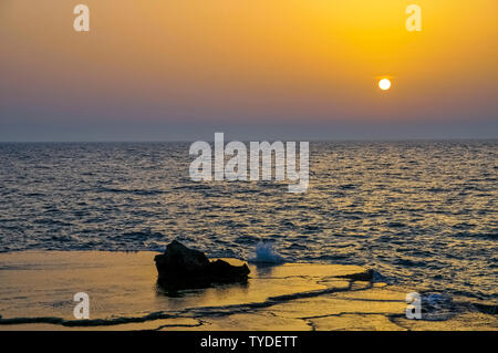 Sunset over the Mediterranean Sea at Achziv Beach, Northern Israel - Stock Photo