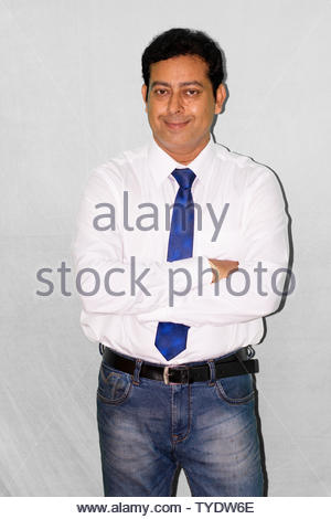 Portrait of young Indian businessman in formal dress - Stock Photo