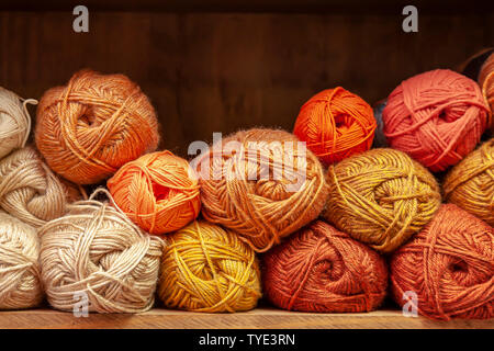 Display of different coloured knitting wools. - Stock Photo