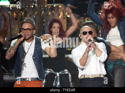Latin singers Sensato (Left) and Pitbull rehearse for the 2012 Billboard Latin Music Awards at the BankUnited Center, Coral Gables, Florida on April 25, 2012. UPI/Gary I Rothstein - Stock Photo