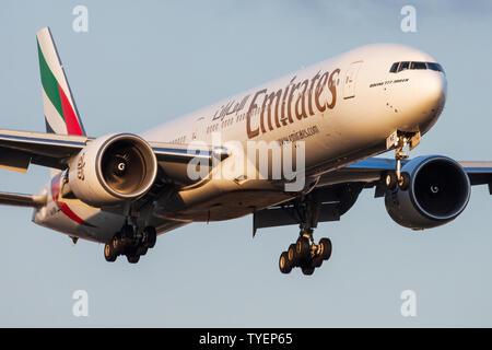 FRANKFURT / GERMANY - AUGUST 20, 2013: Emirates airlines Boeing 777-300ER A6-ENE passenger plane landing at Frankfurt Airport - Stock Photo