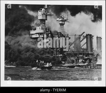 Photograph of a small boat rescuing a seaman from the burning USS West Virginia in Pearl Harbor - Stock Photo