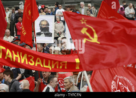 Russian communist party members and young supporters march during a traditional demonstration in central Moscow on May 1, 2008. Thousands of communists, members of Russian main political parties and opposition activists staged competing marches in Moscow and other cities Thursday marking the traditional May Day holiday. (UPI Photo/Anatoli Zhdanov) Stock Photo