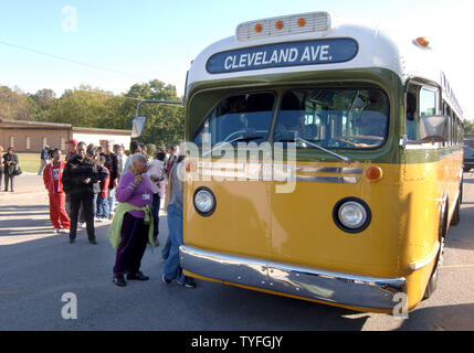 Visitors to the St. Paul AME church in Montgomery, Al. on October 29, 2005, line up to make a brief tour of a replica of the bus where Rosa Parks refused to give up her seat to a white male passenger in December of 1955. Her defiant act led to the U.S. Supreme Court decision in 1957 declaring segregated busing unconstitutional. Ms. Parks, who became a civil rights icon, died of natural causes at age 92 in her Detroit home on Monday, October 24, 2005. Her body was brought here, her home church, for a public viewing and memorial. (UPI Photo/John Dickerson) - Stock Photo