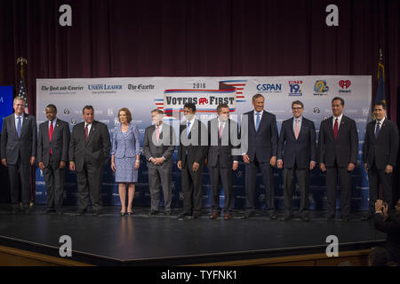 Republican presidential candidates, from left to right, Jeb Bush, Ben Carson, Gov. Chris Christie (R-NJ), Carly Fiorina, Sen. Lindsey Graham (R-NC), Gov. Bobby Jindal (R-LA), Gov. John Kasich (R-OH), George Pataki, Rick Perry, Rick Santorum and Gov. Scott Walker (R-WI), arrive on stage for the Voters First forum at St. Anselm College in Manchester, New Hampshire on August 3, 2015. Fourteen Republican presidential candidates, three via satellite,  excluding Donald Trump, participated in the forum which kicked off the Presidential debate schedule for the 2016 presidential election. Photo by Matt - Stock Photo