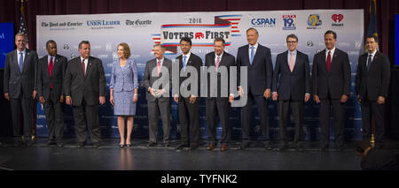Republican presidential candidates, from left to right, Jeb Bush, Ben Carson, Gov. Chris Christie (R-NJ), Carly Fiorina, Sen. Lindsey Graham (R-NC), Gov. Bobby Jindal (R-LA), Gov. John Kasich (R-OH), George Pataki, Rick Perry, Rick Santorum and Gov. Scott Walker (R-WI), arrive on stage for the Voters First forum at St. Anselm College in Manchester, New Hampshire on August 3, 2015. Fourteen Republican presidential candidates, excluding Donald Trump, participated in the forum which kicked off the Presidential debate schedule for the 2016 presidential election. Photo by Matthew Healey/UPI - Stock Photo