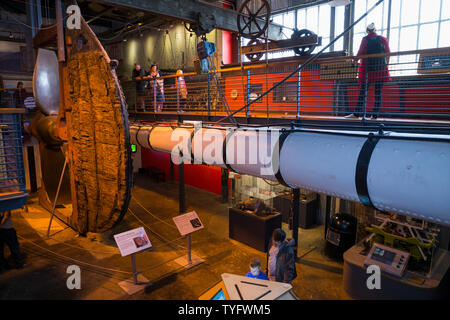 The SS Great Britains white painted main yard ( which would have been slung from the main mast of the ship ) inside The Dockyard Museum at Brunel's SS Great Britain in Bristol. UK. The ships wooden rudder can be seen in the distance. (109) - Stock Photo
