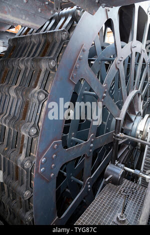 Re-created engine on the arrangement of gearwheels, gear chains and engine cylinders the SS Great Britain, Brunel's steam powered iron ship in dry dock in Bristol, UK. (109) - Stock Photo
