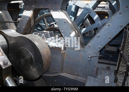 Re-created engine and the arrangement of gearwheels, gear chains and engine cylinders the SS Great Britain, Brunel's steam powered iron ship in dry dock in Bristol, UK. (109) - Stock Photo