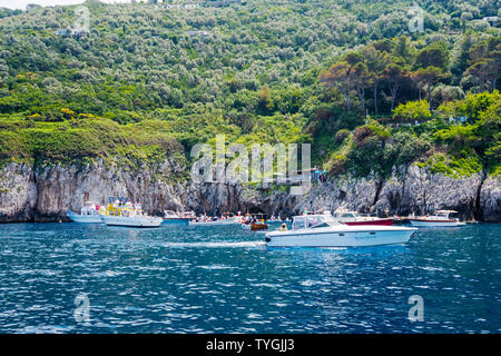 Tourist boats queueing in front of the Blue Grotto, Isle of Capri, Italy - Stock Photo