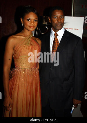 Actor Denzel Washington and his film co-star Kimberly Elise pose at the July 19, 2004 New York world premiere of their film 'The Manchurian Candidate' (UPI Photo/Ezio Petersen) - Stock Photo