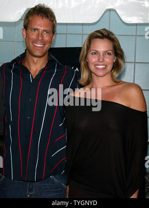 Daniel Travis and Blanchard Ryan pose for pictures at the screening of 'Open Water' at the Chelsea West Cinemas in  New York on August 2, 2004 .   (UPI Photo/Laura Cavanaugh) - Stock Photo