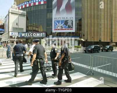 Police patrol the area around Madison Square Garden as security is on high alert two days before the start of the Republican National Convention in New York City August 27, 2004. (UPI Photo/Monika Graff) - Stock Photo
