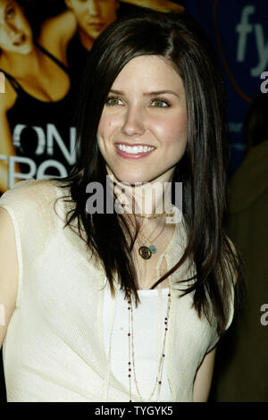 'One Tree Hill' castmember Sophia Bush signs copies of the shows soundtrack CD and performs for the crowds at FYE in New York on January 25, 2005.  (UPI Photo/Laura Cavanaugh) - Stock Photo