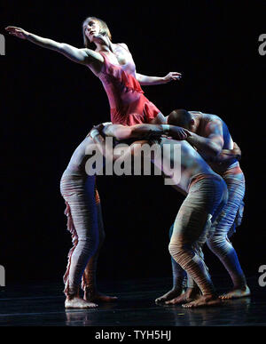 Renee Jaworski and members of the Pilobolus dance company rehearse their new ballet 'Aquatica (2005) ' which will debut on July 11, 2005 at New York's Joyce theatre.  (UPI Photo/Ezio Petersen) - Stock Photo