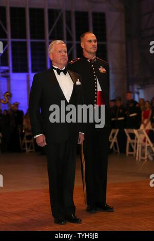 Left, retired Gen. James F. Amos and Col Robert Cooper, right, stand at attention as the U.S. and Marine Corps's Colors are retired during a ceremony at the Marine Aircraft Group 31's Marine Corps Birthday Ball, aboard MCAS Beaufort, Nov. 9. Amos was the Commanding Officer of MAG-31 and the 35 Commandant of the Marine Corps. Cooper is the current Commanding Officer of MAG-31. - Stock Photo