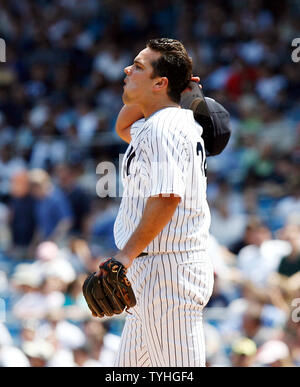 New York Yankees Jaret Wright reacts after throwing a ball in the top of the 5th inning at Yankees Stadium in New York City on May 17, 2006. The New York Yankees host the Texas Rangers.  (UPI Photo/John Angelillo) - Stock Photo