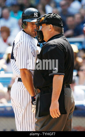 New York Yankees Johnny Damon has words with the umpire after striking out in the bottom of the 3rd inning at Yankees Stadium in New York City on May 17, 2006. The New York Yankees host the Texas Rangers.  (UPI Photo/John Angelillo) - Stock Photo