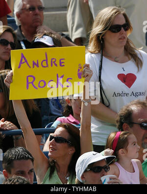 Fans of Andre Agassi hold up signs a wear shirts to support him. Andre Agassi lost the final match of his career to Benjamin Becker at the U.S. Open in Queens, New York on September 3, 2006.  Agassi is retiring after the U.S. Open.   (UPI Photo/John Angelillo) - Stock Photo