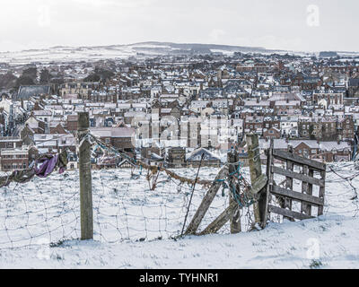 View of Whitby town centre in snow from St Mary's Church. Whitby, North Yorkshire, UK. - Stock Photo