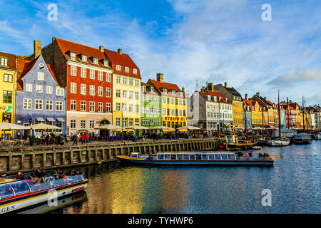 Nyhavn, a 17th century canal and harbour area with bars and restaurants and popular with tourists, in the capital city of Copenhagen, Denmark. 2019.