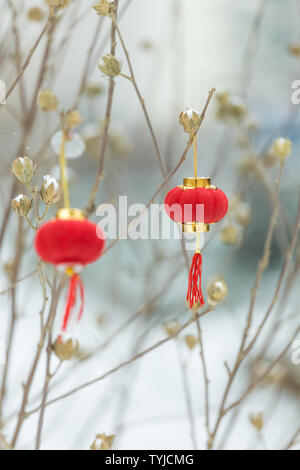 Red lanterns in the snow - Stock Photo