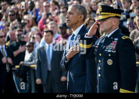 President Barack Obama and Maj. Gen. Bradley A. Becker, Commanding General U.S. Army Military District Of Washington pay their respects after placing a wreath at the Tomb of the Unknown Soldier in observance of Veterans Day, in Arlington National Cemetery, Arlington, Va., Nov. 11, 2016. - Stock Photo