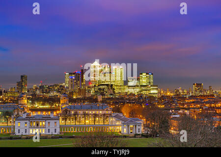 Night view of The Old Royal Naval College & National Maritime Museum with the towers of Canary Wharf in the background  from Greenwich Park ,London - Stock Photo