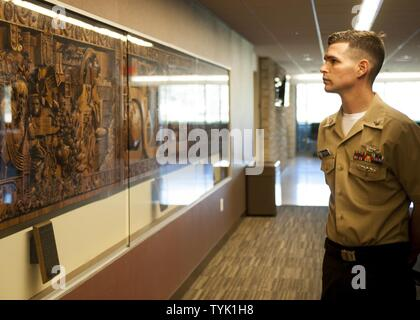 COLLEGE STATION, Texas (Nov. 16, 2016) Petty Officer 2nd Class Andrew Tonski, 2016 Junior Sailor of the Year for the aircraft carrier USS George H.W. Bush (CVN 77), views the history of Texas A&M University during a tour of the campus at College Station, Texas. The tour is part of a two-day namesake trip to Texas where Sailors engaged with the local community about the importance of the Navy.