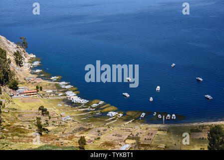 Boats in the Playa Japapi bay on Isla del Sol, Lake Titicaca, Bolivia - Stock Photo