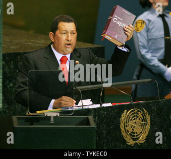 Venezuelan President Hugo Chavez Frias holds up a book titled 'Capitol' during his address to the 64th General Assembly at the United Nations on  September 24, 2009 in New York City.     UPI /Monika Graff