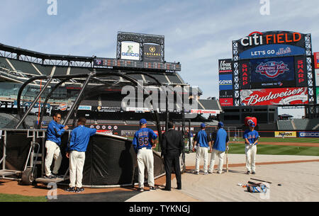 d47f14a83 ... New York Mets players take batting practice before playing the Florida  Marlins on Opening Day at