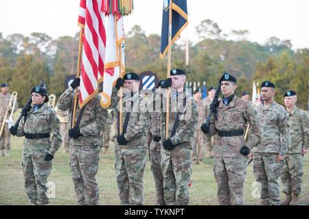 The 3rd Infantry Division color guard participates in the annual Twilight Tattoo during Marne Week at Fort Stewart Nov. 15, 2016. Twilight Tattoo is a ceremony honoring veterans and family members. - Stock Photo