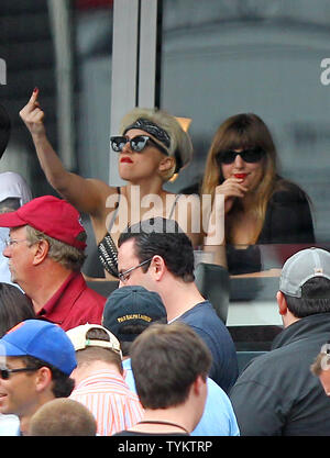 Lady Gaga puts up her middle finger  while the New York Mets play San Diego Padres at Citi Field in New York City on June 10,  2010.   UPI/John Angelillo - Stock Photo