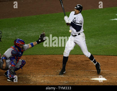 Alex Rodriguez of the New York Yankees is hit by a pitch as Bengie Molina catches for theTexas Rangers in the fourth inning during game four of the ALCS at Yankee Stadium on October 19, 2010 in New York.     UPI/Monika Graff - Stock Photo