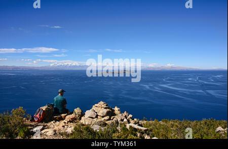 View of the entire Cordillera Real across Lake Titicaca, Isla del Sol, Bolivia - Stock Photo