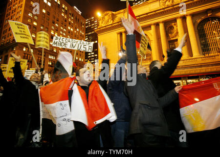 Hundreds of Egyptian-Americans march along 42nd Street past Grand Central Station towards the Egyptian Consulate to protest Egyptian President Hosni Mubarak on February 4, 2011 in New York City. The demonstration coincides with a larger rally in Cairo which has been called 'the day of departure' and follows days of protesting by Egyptians frustrated with Mubarak's leadership.     UPI /Monika Graff - Stock Photo