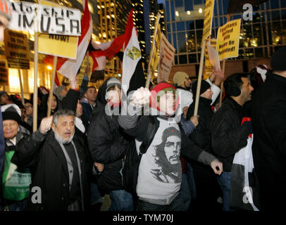Hundreds of Egyptian-Americans march along 42nd Street.towards the Egyptian Consulate as they protest Egyptian President Hosni Mubarak on February 4, 2011 in New York City. The demonstration coincides with a larger rally in Cairo which has been called 'the day of departure' and follows days of protesting by Egyptians frustrated with Mubarak's leadership.     UPI /Monika Graff - Stock Photo