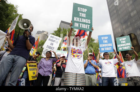 Tibetans and supporters protest the Chinese Foreign Minister, Yang Jiechi, at the United Nations headquarters in New York City, September 26, 2011.      UPI/John Angelillo - Stock Photo