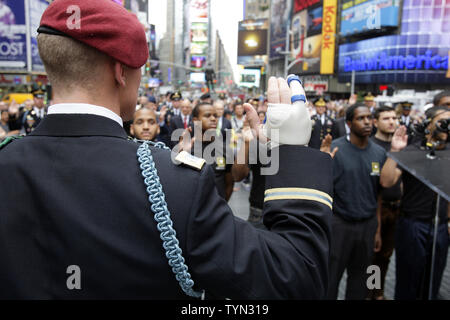 U.S. Army Chief of Staff Gen. Raymond T. Odierno (R) swears in United States Army recruits, accompanied by the U.S. Army Band in Times Square on Flag Day in New York City on June 14 2012.  UPI/John Angelillo. - Stock Photo