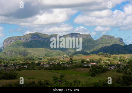Elevated view of the town of Vinales with mogotes behind in the Vinales Valley, Pinar Del Rio Province, Cuba, Caribbean - Stock Photo