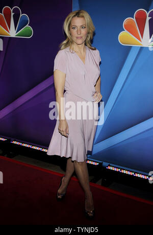 Gillian Anderson arrives on the red carpet at the 2013 NBC Upfront Presentation at Radio City Music Hall in New York City on May 13, 2013.    UPI/John Angelillo - Stock Photo