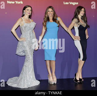 Sofia Vergara stands between two wax figures created for her at Madame Tussauds in New York City on June 4, 2013. The two new wax figures were unveiled at Madame Tussauds in New York. One will be displayed in at Madame Tussauds New York and one at Madame Tussauds Las Vegas.       UPI/John Angelillo - Stock Photo