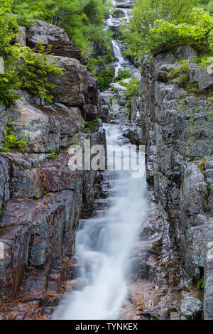 Silver Cascade in Crawford Notch State Park in the New Hampshire White Mountains during the spring months. - Stock Photo
