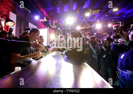 24 year old Joey Chiu from Brooklyn reacts when he is the first to purchase the new PlayStation 4 at a party celebrating the launch of the Sony PlayStation 4 in New York City on November 14, 2013. PlayStation also announced a limited number of units will be available for sale at the event on November 15.      UPI/John Angelillo - Stock Photo