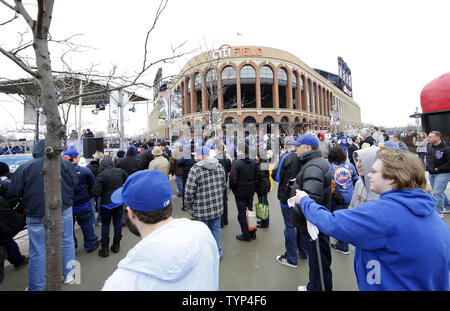 Fans gather outside the ball park before the New York Mets play the Washington Nationals on Opening Day at Citi Field in New York City on March 31, 2014.   UPI/John Angelillo - Stock Photo