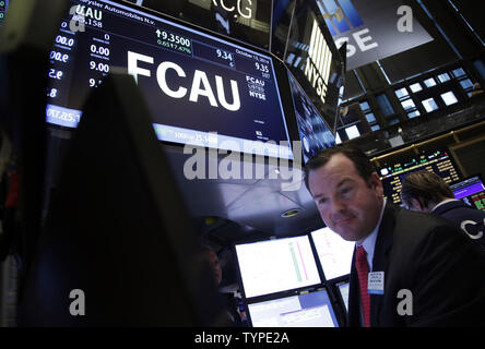Traders work after Fiat Chrysler Automobiles begins trading for the first time on the New York Stock Exchange at the opening bell on Wall Street in New York City on October 13, 2014. Fiat Chrysler Automobiles began trading on the New York Stock Exchange on Monday under the symbol FCAU.     UPI/John Angelillo - Stock Photo