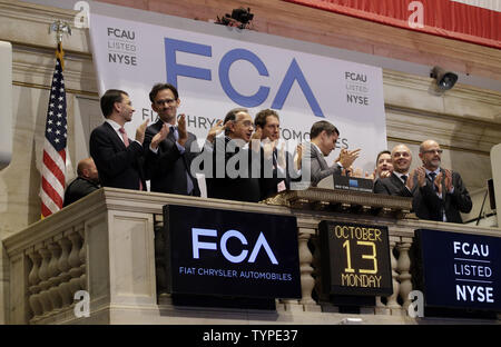 Fiat Chrysler Automobiles CEO Sergio Marchionne and company Chairman John Eikann ring the closing bell at the New York Stock Exchange on Wall Street in New York City on October 13, 2014. Fiat Chrysler Automobiles began trading on the New York Stock Exchange on Monday under the symbol FCAU. Stocks ended Monday's volatile session sharply lower as selling intensified in the last hour with the Dow falling 223 points.     UPI/John Angelillo - Stock Photo