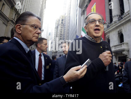 CEO Fiat Chrysler Automobiles Sergio Marchionne speaks to the media outside of the NYSE after the opening bell on the first day of public trading of Ferrari at the New York Stock Exchange on Wall Street in New York City on October 21, 2015. The company's stock priced its initial public offering at $52 a share after the market close on Tuesday, with sources saying the demand for shares was 'well oversubscribed.' The price was at the top of the previously indicated range of $48 to $52 per share. Ferrari RACE shares were trading at $58.18 up almost 10 percent Wednesday in its debut on the New Yor - Stock Photo